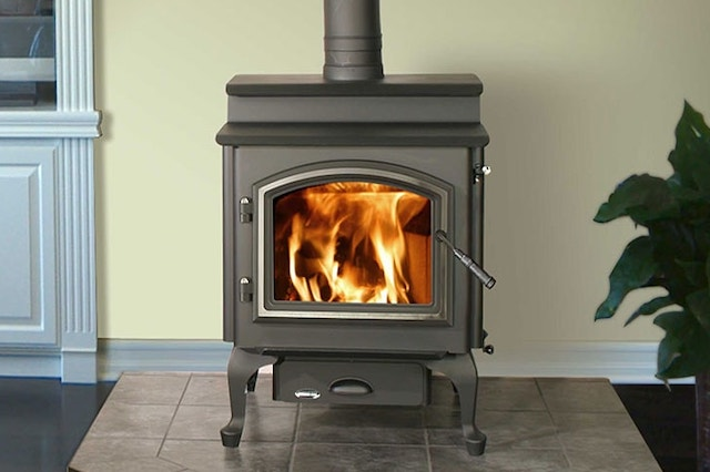 small wood burning stove with fire inside
